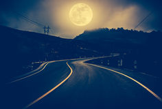 Landscape of nighttime with curvy roadway at national park. Vin. Landscape of full moon with curvy roadway in forest at national park. Mountain winding road stock photography