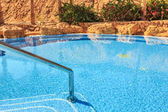 Landscape with nobody swimming pool at luxury hotel Royalty Free Stock Photography