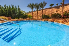 Landscape with nobody swimming pool at luxury hotel Stock Images