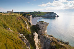 Landscape of the Normandy coast in France. Impressive view of the cliff of the Normandy coast in France with a church Royalty Free Stock Photos