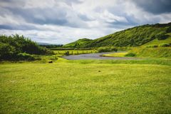Landscape in Northern Ireland County Antrim Ballycastle. Overcast skies and lush green colored hills and land in Northern Ireland County Antrim near Ballycastle stock photography