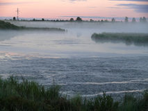 The landscape of the Northern nature. Fog over the river Nadym. Stock Photos