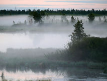 The landscape of the Northern nature. Fog over the river Nadym. Royalty Free Stock Photo
