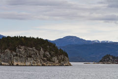 Landscape in norway - coastline in fjord Royalty Free Stock Photo