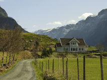 Landscape in norway with house in deep valley Royalty Free Stock Image