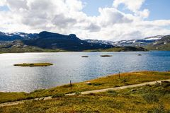 Landscape in Norway. Landscape with mountains, lake, sky and clouds in Norway Stock Images