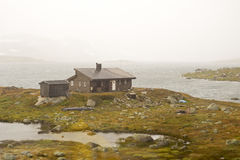 Landscape of Norway. Mountains and shed, view from train stock image