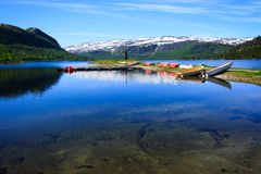 Landscape in Norway with water, mountains and boats Royalty Free Stock Images
