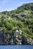 Landscape of the Norwegian coast, water, rocks and forest, summe. R time Stock Photos