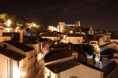 Landscape of Obidos, Portugal. Night scene with long exposure of medieval obidos with castle in background Stock Photography