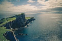 Landscape of Ocean Cliffs with Lighthouse Stock Image