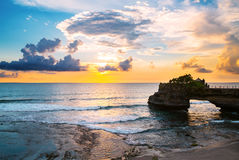 Landscape, Ocean in sunset with cliff and natural arch at Tanah lot, Bali Stock Image
