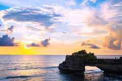 Landscape, Ocean in sunset with cliff and natural arch at Tanah lot, Bali Stock Photo