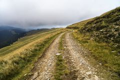 Landscape with offroad on the mountain somewhere. Landscape with offroad on the mountain somewhere in Romania royalty free stock photos
