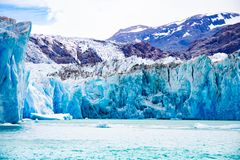 The imposing O`higgins Glacier. Landscape of Ohiggins Glacier and Ohiggins Lake with its mountains that surround it. Austral road. Region of Aysen. Chile stock images