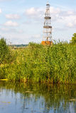 Landscape with oil derrick Royalty Free Stock Photo