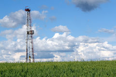 Landscape with oil drilling rig Royalty Free Stock Image