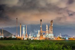 Landscape of oil and gas refinery plant before storm Stock Photos