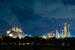 Landscape of oil refinery industry with oil storage tank in nigh Stock Image