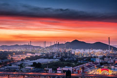 Landscape of oil refinery plant and city at twilight scene. Stock Images