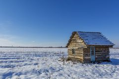 Landscape of old abandoned farm house covered with snow in a frosty winter. Stock Image