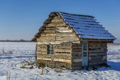 Landscape of old abandoned farm house covered with snow in a frosty winter. Royalty Free Stock Photography
