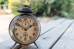Landscape with old alarm clock Royalty Free Stock Photography