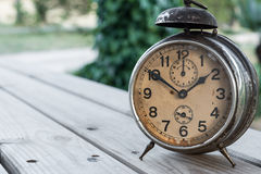 Landscape with old alarm clock Royalty Free Stock Image