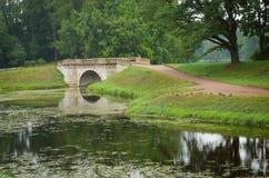 Landscape with old bridge Stock Photos