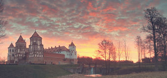 Landscape of the old castle against the background of dawn. stock photo