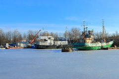 Landscape with old fishing trawlers at wintering Royalty Free Stock Photos