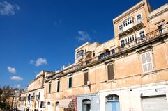 Landscape of old, historic street in Valletta, Malta. Landscape of an old, historic street in Valletta, Malta, with traditional architecture: stoned facades and stock image