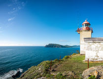 Landscape with an old lighthouse and sea. Panoramic view with an old lighthouse Royalty Free Stock Images