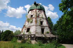 Landscape with an old mill. Summer landscape with an old abandoned mill Royalty Free Stock Photography