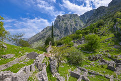 The landscape with old orthodox church. The old orthodox church and ruins of houses in the mountains above the Kotor city, Montenegro Royalty Free Stock Images