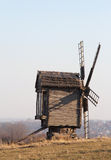 Landscape with an old Ukrainian wooden mill. Stock Photos