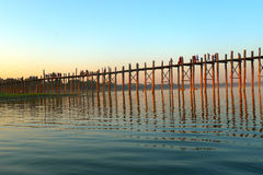 Landscape of an old wooden bridge in Myanmar. Landscape of a famous old wooden bridge named Ubein in Mandalay Myanmar. Used for news and essays or webpages on royalty free stock photo