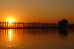 Landscape of an old wooden bridge at sunset Stock Photos