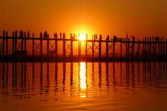 Landscape of an old wooden bridge at sunset Stock Image