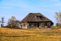 Landscape with old wooden house Royalty Free Stock Image