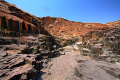 Landscape in Organ Pipes. Organ pipes: basalt rock formation in Namibia royalty free stock photos