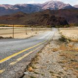 Landscape with the outgoing road. Altai Mountains. Landscape with the outgoing road against the backdrop of the Altai Mountains stock photo