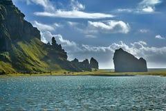Reynisdrangar, stacks of basalt rock, autumn 2018, Iceland. Offshore lie stacks of basalt rock, remnants of a once more extensive cliffline Reynisfjall, now stock photos