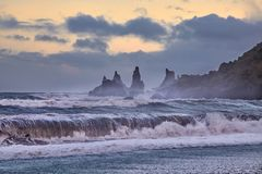 Reynisdrangar, stormy waves, autumn 2018, Iceland. Offshore lie stacks of basalt rock, remnants of a once more extensive cliffline Reynisfjall, now battered by stock photo