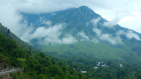 Landscape in Pahalgam-13. A beautiful scene of a mountain covered by monsoon clouds Royalty Free Stock Photography