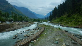 Landscape in Pahalgam-9. A beautiful scene of a river flowing from both sides toward a mountain in the valley of Kashmir Stock Photography