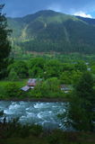 Landscape in Pahalgam-7. A beautiful scene in the season of a monsoon showing lush green mountain and river water flowing with force Royalty Free Stock Photography