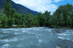 Landscape in Pahalgam-1. A superb landscape with river water with mountains and greenery Royalty Free Stock Images