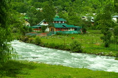 Landscape in Pahalgam-2. A superb landscape with a traditional house placed amidst greenery and river Stock Photos