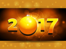 2017 landscape panel background with Christmas bauble. Twenty Seventeen in Golden Numbers and Bauble Glowing Panel Over Glowing Background Stock Photo